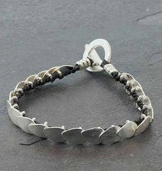"Jill Platner Hydrangea Bracelet - Sterling silver and hand crocheted teflon cord Hydrangea bracelet.  6 3/4"", toggle clasp."