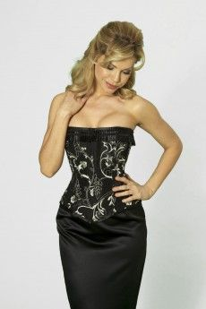 5546cf5a37 Bewitching Corset - Shown in white embroidery on black taffeta with a  pleated lace trim finish