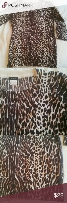JCrew wool pullover sweater Merino wool, animal print with elbow length sleeves. 15.5 inches pit to pit, 16 inches long, 10.5 inch long sleeves. Very good condition, no obvious signs of wear. Dry clean. J. Crew Sweaters Crew & Scoop Necks