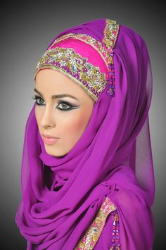 the folds and drapes make this a wonderful look to translate into a bridal hijab.