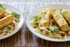 Napa cabbage, carrots, peanuts, scallions, and herbs are tossed with seared tofu and drizzled with an Asian garlic-chile sauce. A tofu lover's salad.