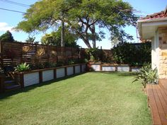 Low corrugated iron and wood retaining wall