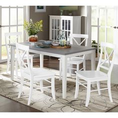 The Simple Living 5pc Helena Dining Set features a contemporary style complemented with white and grey two toned cool finish that is sure to add flair to any decor. Choose from four chairs in either white or grey to match with the table.