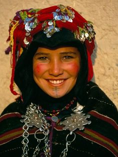 Africa |  Berber girl Morocco. In Morocco's High Atlas mountains virgins like 12-year-old H'dda may catch the eye of a suitor at the annual brides' fair in the village of Imilchil. If her parents approve, a prolonged courtship begins. Under Moroccan law girls cannot marry until 16, but many Berbers keep their own counsel. | ©  Carol Beckwith and Angela Fisher