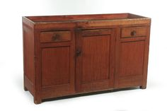 """AMERICAN DRY SINK.  Attributed to New York, 2nd half-19th century, pine. Dovetailed gallery and two drawers. Interior shelf. Original red paint. Wear. 32.5""""h. 51.5""""w. 19""""d."""
