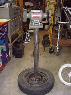 Bench Grinder Stand by Mark Johnson -- Homemade bench grinder stand constructed from a surplus VW wheel and tire, pipe, and steel plate. http://www.homemadetools.net/homemade-bench-grinder-stand-4