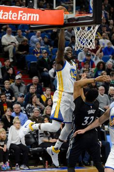 Draymond Green of the Golden State Warriors shoots the ball against KarlAnthony Towns of the Minnesota Timberwolves during the second quarter of the...