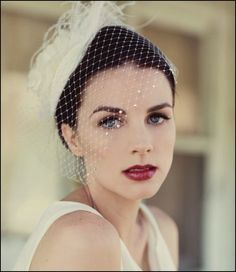 Her dark hair pulled back against her pale complexion makes for a beautiful and dramatic look
