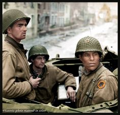 Soldiers of an anti-tank unit entering the French city of Saint-Lô in Normandy, France, on 19 July 1944.