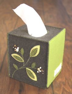 This is a really cool idea.  I have tissue boxes everywhere and hate how they look.  An easy and fairly quick idea.