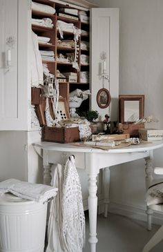 .put books and papers in the shelves above the table. (although the linens are lovely and inspiring in their own way!)