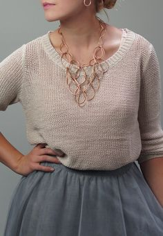 mix a tulle skirt with a sweater and statement necklace for a holiday outfit that chic and cozy at the same time!