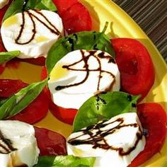 Caprese Salad with Balsamic Reduction - The lovely Italian salad of sliced tomato, mozzarella cheese, and fresh basil leaves gets a drizzle of sweet, tangy balsamic vinegar reduction for a gourmet summer treat. Balsamic Reduction Recipe, Frozen Garlic Bread, Appetizer Recipes, Appetizers, Salad Recipes, Appetizer Dishes, Jar Recipes, Gastronomia, Vegetarian Recipes