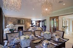 Showstopping chandeliers frame the dining area © Hill House Interiors