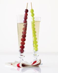 New Year's Champagne with Grapes      In Spain, revelers mark the New Year by quickly eating a dozen grapes at midnight. Why not adopt the tradition by serving them with a glass of Champagne?