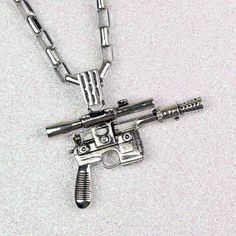 Han Cholo x Star Wars Han Solo Blaster stainless steel necklace ⭐️ Star Wars fashion ⭐️ Geek Fashion ⭐️ Star Wars Style ⭐️ Geek Chic ⭐️ Geek Fashion, Star Fashion, Han Solo Blaster, Star Wars Jewelry, Star Wars Han Solo, Jewelry Tattoo, Themed Outfits, Stainless Steel Necklace, Photos Of Women