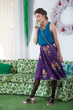 Mix and match with panache for work or the weekend with versatile separates like this purple floral A-line skirt and blue collared tank top!