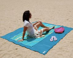 """Sandless Beach Mat, $59.95 """"Sandless"""" you say? It's possible thanks to woven polyurethane, which filters out grains of sand."""