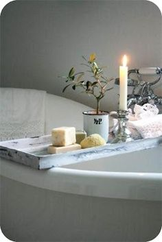 Simple wooden tray for over a claw foot bathrub.  What's on your bath tray?  Candles, French soap, Fresh herbs and a sea sponge.  Live Beautifully!