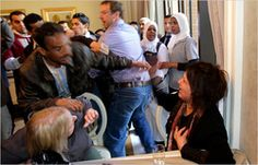 This news footage is of a Libyan woman, Eman al-Obeidy, who recently entered a Tripoli hotel full of foreign journalists. Although not shown in the video, al-Obeidy claimed to have been detained at a checkpoint in the Libyan capital by forces loyal to Muammar el-Qaddafi and some time thereafter raped by 15 men.     http://thelede.blogs.nytimes.com/2011/03/26/video-of-libyan-woman-dragged-away-from-foreign-press-corps/