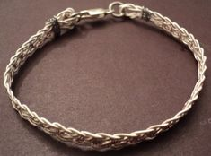 Make a Bracelet Out of Used Guitar Strings.- Make a Bracelet Out of Used Guitar Strings. Make a bracelet out of used guitar strings. Wire Jewelry, Jewelry Crafts, Jewelery, Handmade Jewelry, Jewelry Ideas, Music Jewelry, Guitar Crafts, Guitar Art, Guitar String Bracelet