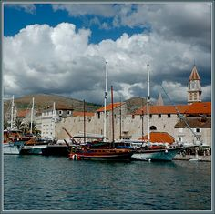 Marina in Trogir, Croatia - Photo © Bulent Atalay - Trogir is a medieval town in the Dalmatian coast of Croatia. Not until the 1970s, however, would the quality of life begin to improve significantly, when the shipbuilding industry began to flourish, offering employment to over 50% of the inhabitants of Trojir. It was this industry, coupled with an accelerated growth of tourism that brought prosperity to the citizens. UNESCO acknowledged Trogir as a World Heritage Site in 1997. #Travel…