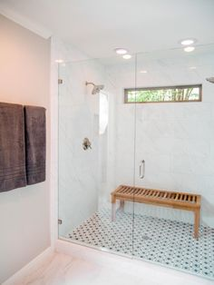 In the master bath, a small shower was removed to make way for an adjacent shoe closet. A tub was also eliminated and replaced with a larger, glass-enclosed walk in shower.