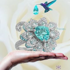 The Paraiba Flower Ring it's a #dream  #ring by #samuelsylvio #gorgeous #amazing #oneofakind #collector #bling #bride #theknot #omg #gemstone #gem #ringoftheday #agta #luxury #luxuryfashion #luxurylife #dropdead #swoon #moskow #hollywood #rare #jck #vegas #paraiba #paraibatourmaline #jewelry #jewelryblogger #jewelrydesign