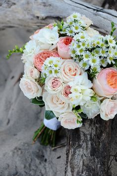 A garden-inspired wedding bouquet with garden roses, spray roses, freesia, herbs and spray aster. Florals by freshdesign. Photography - Artist Group Photography