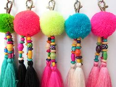 Luisa Tasselled Keychain Trio of Long Silky Tassels Large Handmade Wool Pom Pom Beadwork Bag Charm Trio Tassel Keyring Gift For Her    Featuring handmade fluffy wool pom pom complete with wood and glass colored beadwork and a trio of 4 silky luxe tassels,complete with brass clasp. Total length approx 7  Please select your preferred combination from the list below and leave in the NOTE box after checkout 1. Lime Green Pom Turquoise tassels 2. Orange Pom Black tassels 3. Neon Yellow Pom Pink…