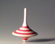Red striped funnel shaped spinning top