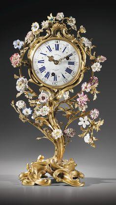 A GILT BRONZE MOUNTED PORCELAIN MANTEL-CLOCK LOUIS XV 1753