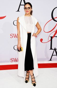 Katherine McPhee in a black and white look, accessorizing with pointed strappy heels and Leisure Society glasses