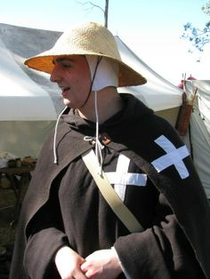 My recreation of a Brother-Sergeant whilst on campaign. Brothers wore a black or brown Cappae with a white cross on the chest, over plain linen under garments. In colder weather or whilst on the road Brothers also wore a plain black mantle, again with a white cross on the chest. A rope belt girded the waist and Brothers had to cover their heads at all times – in their case with a coif and straw cap. Equipment examples date from between 1180-1230AD.
