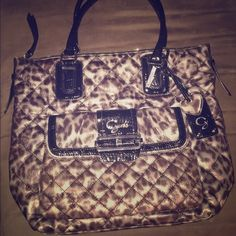 LIKE NEW AUTHENTIC GUESS BAG GOURGEOUS like new cheetah print Guess bag. Used once and never again. Perfectly clean on inside and outside. Magnetic flap on outside! Guess Bags