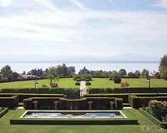 The back garden of Fawaz Gruosi and Caroline Gruosi-Scheufele's villa, which overlooks Lake Geneva, in Prangins, Switzerland.