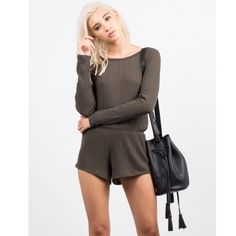 """Ribbed Long Sleeve Romper Get super comfy in this one piece! The Ribbed Long Sleeve Romper features ribbed material, long sleeves, and stretchy waistband. Pair this romper with a pair of suede over the knee boots and long chunky knit cardigan for the perfect and comfy Fall outfit. This romper is made from 65% Polyester and 35% Rayon. We recommend to Hand Wash Cold. Made in USA.  Model is wearing size small and a size 3 in jeans. Height: 5'7"""" - Bust: 31"""" - Waist: 23"""" - Hips: 34.5"""". Dresses…"""