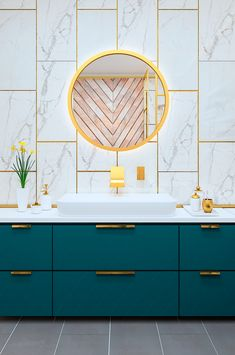 Gorgeous and bright, this is such a fabulous modern bathroom in teal and white with marble and brass.