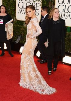 WOW! J.Lo wore a stunning nude and lace gown! More Photos: http://globalgrind.com/style/golden-globes-2013-red-carpet-jlo-jennifer-lopez-nude-lace-photos