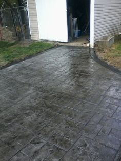 Gray Ashlar slate stamped concrete patio with stained black stained border in Warsaw Wyoming county ny Concrete Patios, Stamped Concrete Driveway, Concrete Floor Coatings, Concrete Patio Designs, Concrete Porch, Driveway Paint, Driveway Landscaping, Driveway Ideas, Landscaping Ideas