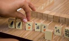 The classic Chinese game of mahjong has evolved into many variations as it has spread across the world. Fun Party Games, Fun Games For Kids, Playing Dice, Kids Playing, Family Game Night, Family Games, Mahjong Online, Dementia Activities, Elderly Activities