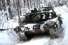 Finnish Leopard 2A4 with winter camouflage in forest