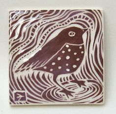 A little spotted bird in a nice plum color.    Hand-carved of white earthenware tile.