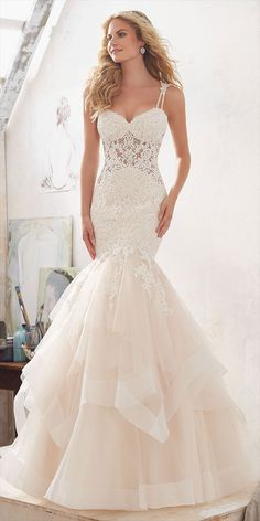 Diamant Beaded, Alençon Lace Appliqués Adorn the Bodice of this Glamorous Mermaid Wedding Dress. The Flounced Tulle Skirt is Accented with Horsehair Trim. Appliquéd Double Shoulder Straps Complete the Look. Matching Satin Bodice Lining Included.