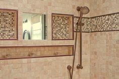 fog-free shower mirror and tiled in niches for bathing essentials