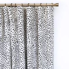 As seen in Style at Home Magazine!A global inspired, painted dot fabric in black on a creamy natural background. Suitable for upholstery, drapery, curtains, rom
