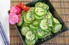 """Japanese Pickled Cucumbers: Mix: 4 Persian cucumbers, sliced 1/4 """" thick & 2 tsp kosher salt, set for 10 mis, rinse in cold water & drain. Mix: 1/4 tsp, 4 T rice vinegar & 2 T sugar. toss with cucumbers, Store overnight. Sprinkle with Black & white sesame seeds,"""