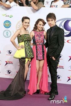 New and Jiew wearing Hmong Modern clothing. Next to them is Nat.
