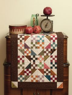 Kim Diehl, homestyle quilts - love the way it is displayed on a vintage cabinet radio