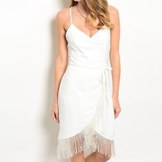 Ivory Faux Wrap Front Dress + Fringe Hem Ivory Fringe Detail V-Neck Wrap Dress | Faux Wrap Dress with Fringe in Ivory  * PRICE FIRM UNLESS BUNDLED V neckline Spaghetti straps Faux wrapped front Fringe accents Self-tie waist sash + fringe Adjustable cross straps at back Concealed side zip Double layer  100% polyester Hand wash cold Dresses Mini